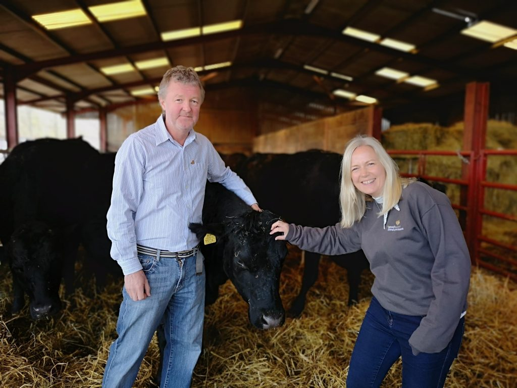 Goodheart Founders stand with one of their rescued cows