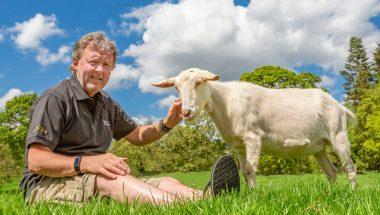 Founder David Walker strokes a white goat